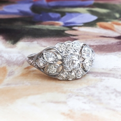 Edwardian Diamond Engagement Ring .63ct t.w. Circa 1920's Old European Cut Floral Filigree Platinum Engagement Ring