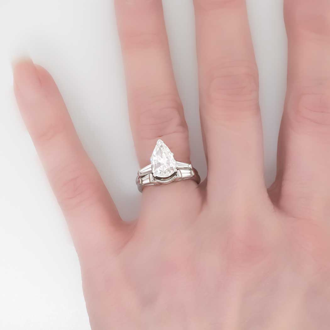 Your best engagement ring: Pear shaped diamond ring on hand
