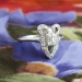 Edwardian 1920's Vintage .49ct t.w. Emerald Cut Diamond Engagement Anniversary Bow Ring Platinum